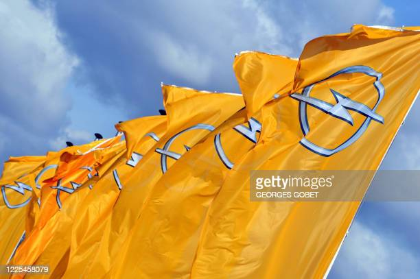 This file photo taken on September 11, 2009 of flags outside the Opel car factory building in Antwerp. After months of deliberation the GM board...
