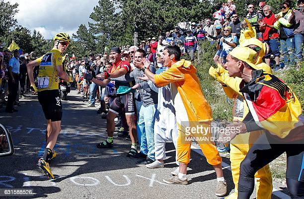 This file photo that won France's LCL/UJSF 2016 photo contest shows yellow jersey leader Team Sky rider Chris Froome of Britain running on the road...