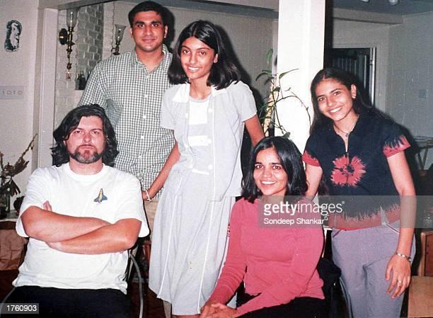 This file photograph shows Sanpreet Kaur and Namita Alung students of Tagore Baal Niketan School posing with astronaut Kalpana Chawla and her husband...