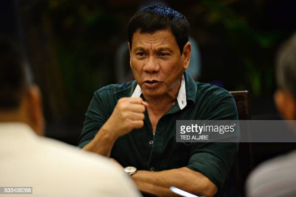 This file photograph taken on May 15 shows Philippines' presidentelect Rodrigo Duterte gesturing as he talks with military and police officials...