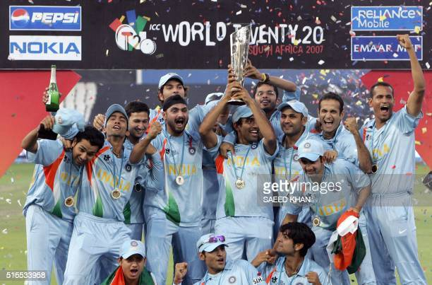 This file photograph taken on September 24 2007 shows Indian cricket team players celebrating with the ICC World Twenty20 trophy after defeating...