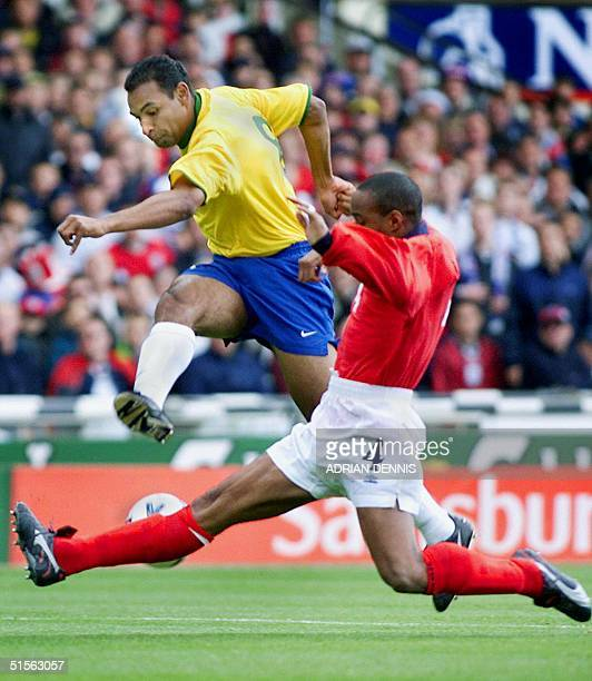 This file photograph was taken during a game between Brazil and England as the Brazilian player Emerson fights for the ball with Paul Ince of England...
