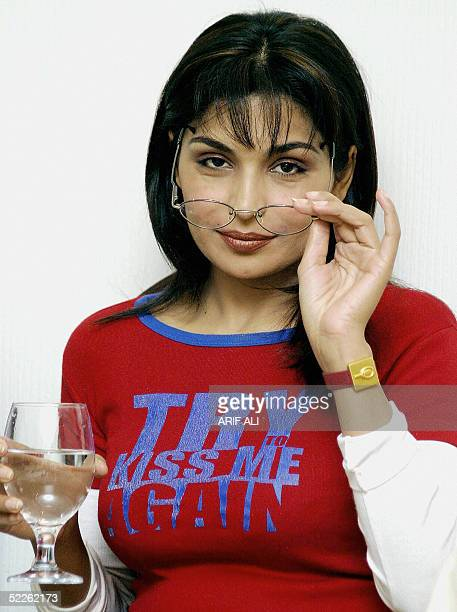 This file picture dated 04 May 2004 shows Pakistani actress Meera posing for a photographer at her home in Lahore Meera asked the government for...