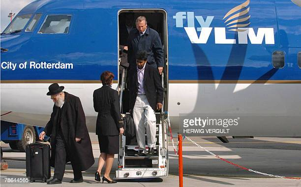 This file picture dated 10 May 2005 shows people getting off a Fokker 50 airplane of VLM at Antwerp Airport Aviation giant AirFranceKLM is to buy out...