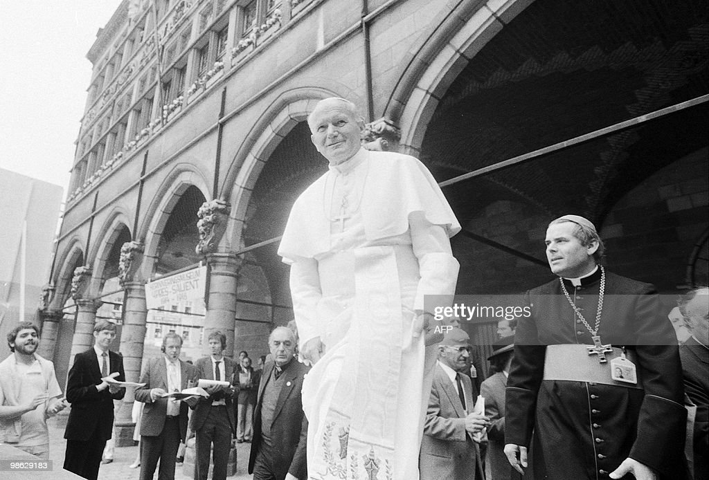 OUT - This file picture dated 17 May 1985, shows Roger Vangheluwe (R) during the visit of late Pope John Paul II (C) to the city of Ieper (Ypres). On April 22, 2010 Brugges' bishop Roger Vangheluwe tendered his resignation amid speculation of phedophilia. The announcement by head of Belgium's catholic church Andre-Joseph Leonard comes in the wake of some 300 formal complaints for acts of pedophilia brought to light in Belgium earlier this month.