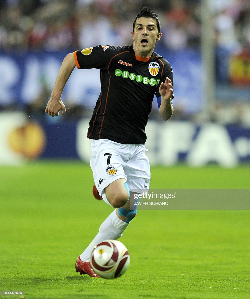 This file picture dated April 8, 2010 shows Valencia's forward David Villa running with the ball during a UEFA Euroleague quarter final second leg football match against Atletico de Madrid at Vicente Calderon stadium in Madrid. Barcelona have reached a deal to sign Spanish international striker David Villa from Valencia for 40 million euros (49.4 million dollars), the Spanish champions said on May 19, 2010. The 28-year-old, Valencia's top scorer in La Liga with 21 goals, will be officially unveiled on May 21, 2010 at the Camp Nou after undergoing a medical.