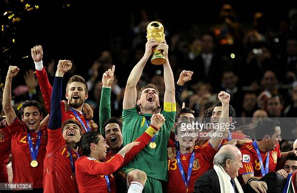 This file picture dated July 11 2010 shows Spain's goalkeeper Iker Casillas holding the FIFA World Cup trophy after winning the 2010 World Cup...