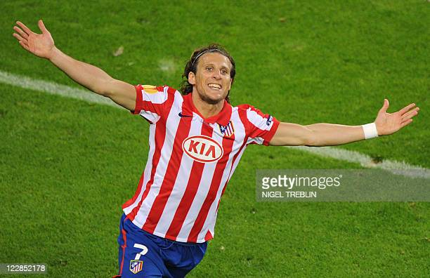 This file picture dated May 12 2010 shows Atletico Madrid's Uruguayan forward Diego Forlan celebrating after scoring during the final football match...
