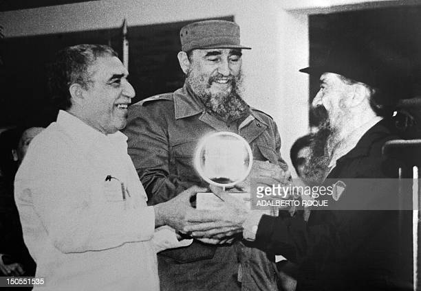 This file picture from December 15 shows former Cuban President Fidel Castro Nobel Literature Prize Gabriel Garcia Marquez and movie director...