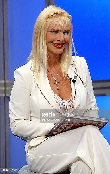 This file picture of former porn star Hungarianborn Ilona Staller better known as Cicciolina taken on August 5 2004 during the presentation of her...