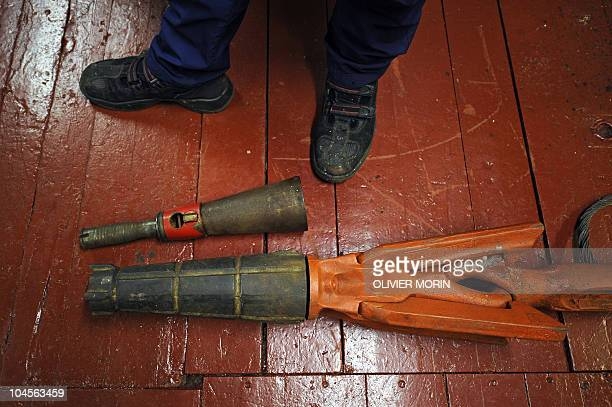 This file picture shows a harpoon with an explosive head, used to hunt whales, on April 21, 2009 in a cabin room of a whaling boat, recently restored...