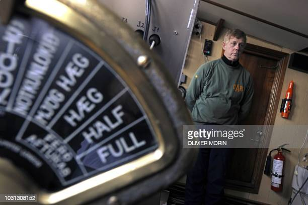 This file picture shows Captain Olafur Olafsson posing on April 21, 2009 in the cockpit of a whaling boat recently restored after being unused for...