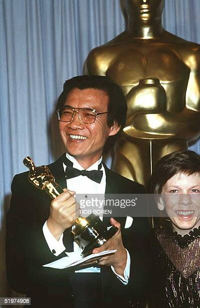 This file picture shows Oscarwinning Cambodian actor Haing Ngor seen 25 March 1985 receiving his Oscar for best supporting actor for his first screen...