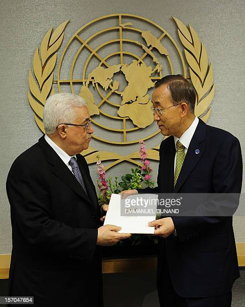 This file picture shows Palestinian Authority President Mahmoud Abbas handing over a formal letter for Palestine to be admitted as a state to the UN...