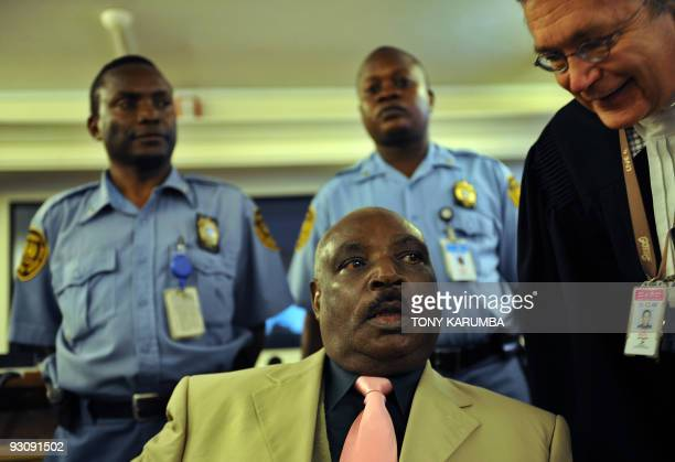 FILES This file picture shows Rwanda's former president Juvenal Habyarimana's brotherinlaw Protais Zigiranyirazo consulting his counsel on December...