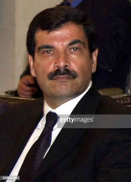 This file picture shows the brotherinlaw of Syrian President Bashar alAssad General Assef Shawkat siting during condolences at the Damascus People's...