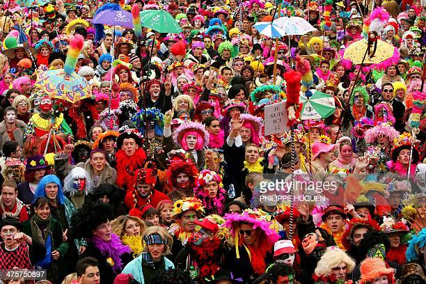 This file picture shows thousands of people parading in the streets of Dunkirk on February 18 2007 during the city's carnival which dates back to the...