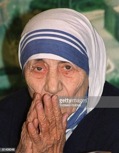 This file picture taken 02 March 1993 shows Mother Teresa greeting the press upon her arrival at Hong Kong's Kai Tak International Airport Mother...