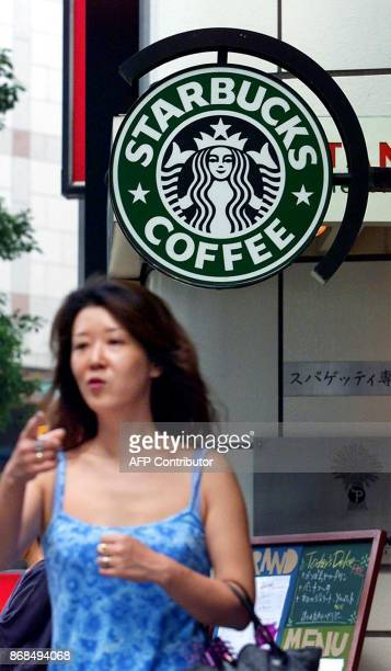 This file picture taken 12 July 2000 shows the oval signboard of Starbucks Coffee in downtown Tokyo Starbucks Coffee Japan Ltd was tightlipped 10...