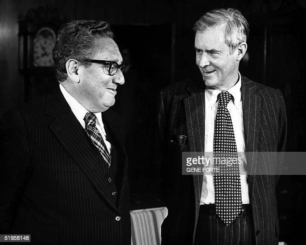 This file picture taken 15 December 1976 shows Secretary of State Henry Kissinger meeting with Secretary of State Designate Cyrus Vance on the...