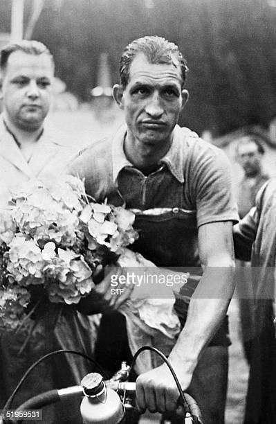 This file picture taken in 1952 shows Italian cyclist Gino Bartali who died 05 May 2000 Italian newspaper Corriere della Sera reported in its 03...