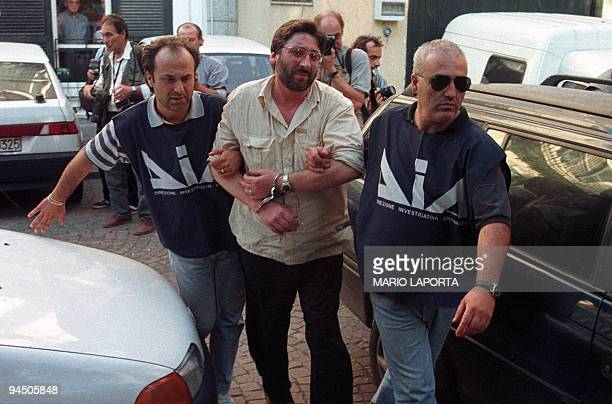 This file picture taken in July 1998 shows Francesco Schiavone, a top mafia leader of camorra's Casalesi clans, arrested by Italian policemen in...