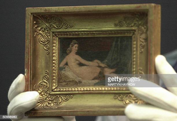 FILES This file picture taken on 06 June 2001 shows a Sotheby's employee holding Odalisque by French artist JeanAugusteDominique Ingres which was...