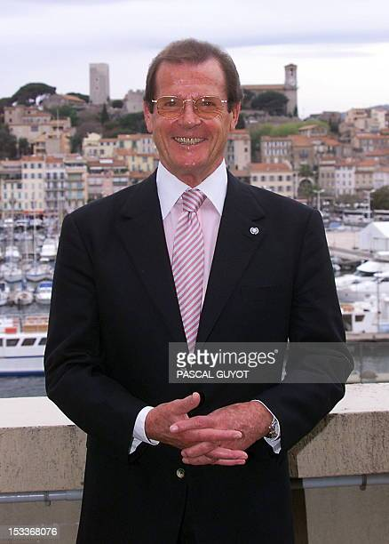This file picture taken on April 13, 1999 shows British actor famed for his role as secret agent James Bond, Roger Moore posing prior the premiere of...