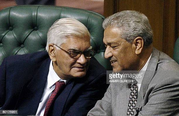 This file picture taken on January 6 shows the father of Pakistan's nuclear bomb Abdul Qadeer Khan talking to Dr Ashfaq Ahmed chairman Pakistan...