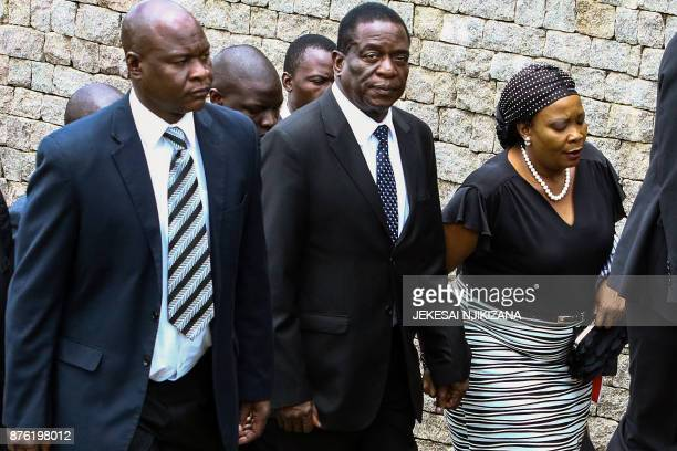 This file picture taken on January 7 2016 shows Zimbabwe acting President Emerson Mnangagwa arriving at the burial of Peter Chanetsa at the National...