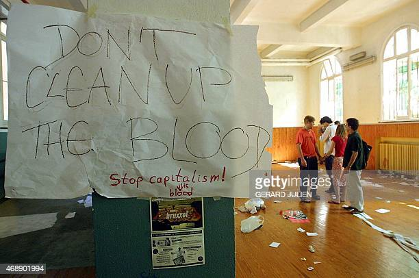 This file picture taken on July 22 2001 at a school in Genoa during a Group of Eight summit shows a note reading 'Don't Clean Up The Blood' hanging...