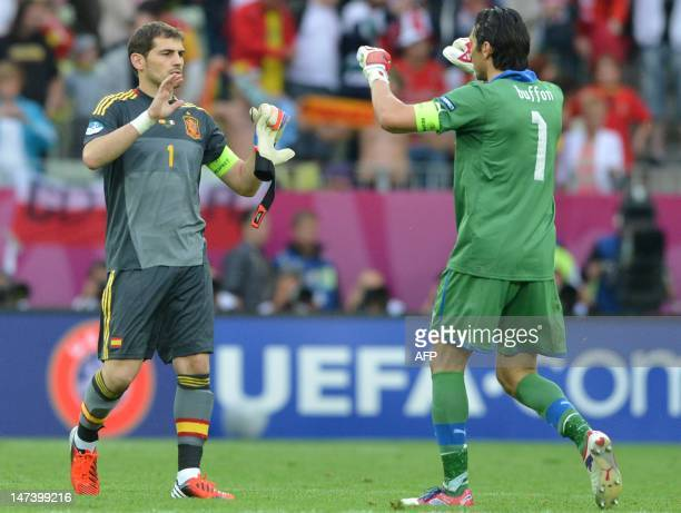 This file picture taken on June 10 2012 at the Gdansk Arena shows Italian goalkeeper Gianluigi Buffon and Spanish goalkeeper Iker Casillas cheering...