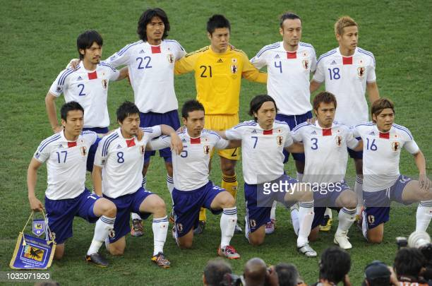 This file picture taken on June 19 2010 at Moses Mabhida stadium in Durban shows Japan's team Japan's midfielder Makoto Hasebe Japan's midfielder...