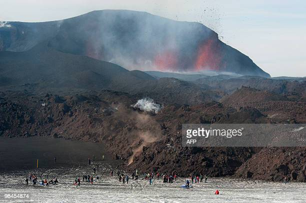 This File picture taken on March 27, 2010 shows tourists gathered to watch lava spurt out of the site of a volcanic eruption at the Fimmvorduhals...