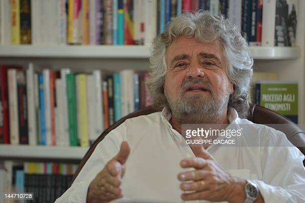 This file picture taken on May 10 2012 in Genoa shows Italian comedian Beppe Grillo speaks during an interview at his home With Italy's economy stuck...