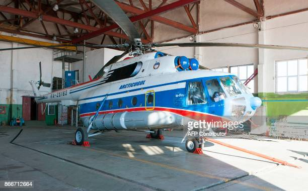 This file picture taken on May 5 2011 shows the Russian helicopter which crashed in the hangar of the base Kapp Heer at Barentsburg Svalbard A...