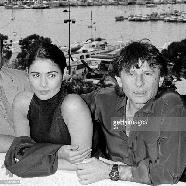 This file picture taken on May 8 1986 shows Film director Roman Polanski and British actress Charlotte Lewis posing prior to the presentation of the...