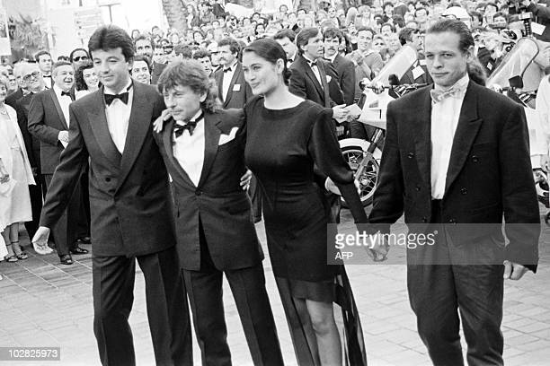 This file picture taken on May 8 1986 shows Film director Roman Polanski British actress Charlotte Lewis and French actor Cris Campion posing prior...