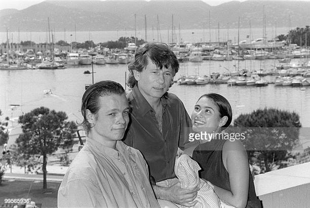 This file picture taken on May 8 1986 shows Film director Roman Polanski with British actress Charlotte Lewis and French actor Cris Campion for the...