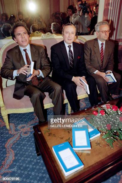 This file picture taken on November 19 1989 shows French writer and publisher Guy Dupre sitting with Jury member Angelo Rinaldi and November Prize...