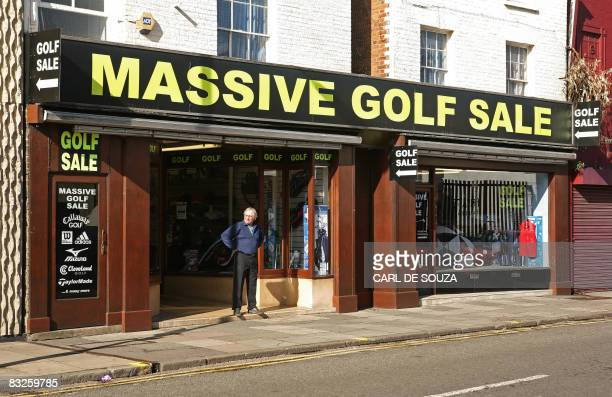 This file picture taken on October 1 2008 in Guildford in southeast England shows a shopkeeper looking out from his golf storeBritish 12month...