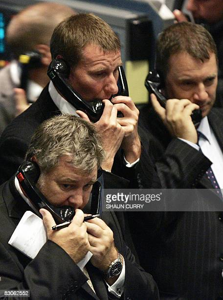 This file picture taken on September 21 2007 in London shows traders operating in the pit at the London Metal Exchange The prices of aluminium copper...