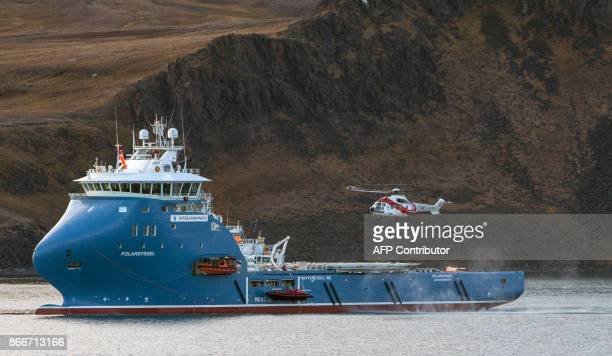 This file picture taken on September 28 2016 shows the ship 'Polarsyssel' at Barentsburg Svalbard A Russian helicopter with eight people on board...