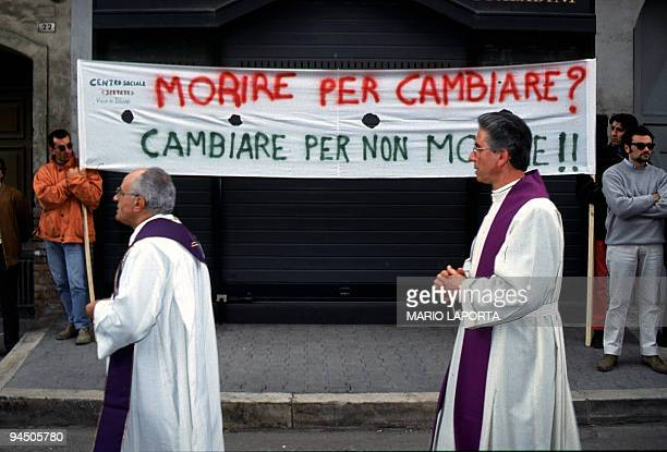 This file picturetaken in March 1994 shows priests marching during the funerals of Italian priest Giuseppe Diana who was killed by members of the...