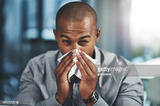 this flu is negatively impacting on my success - flu virus stock photos and pictures