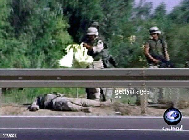 This frame grab from Abu Dhabi satellite television channel shows a US soldier who was killed in an attack 16 July 2003 on a military convoy on a...