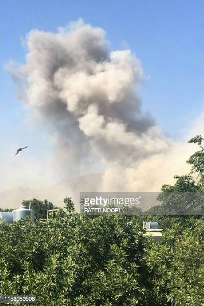 This framegrab taken from AFPTV shows a plume of smoke after an explosion in Kabul on July 1, 2019. - Dozens of people were wounded with fatalities...