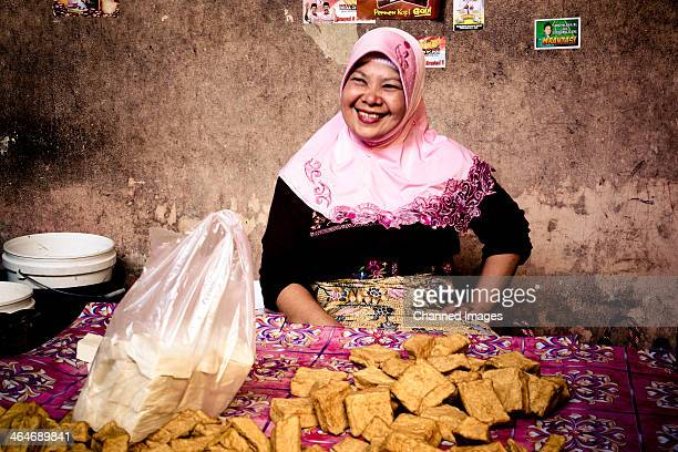 CONTENT] This friendly woman is selling tofu on the market in Borobudur Java Indonesia