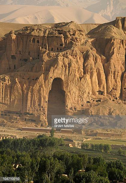This general view from a hilltop shows the empty seat of the Buddha destroyed by the Taliban in Bamiyan on July 7 2008 The cavemonasteries of Bamiyan...