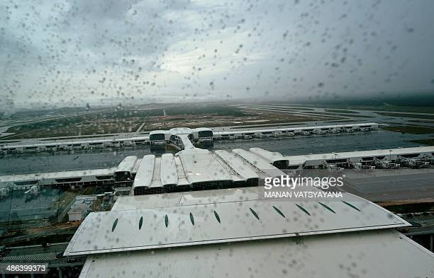 This general view from the new air traffic control tower shows the rain coming down over the soontobe inaugrated lowcost carrier terminal at Kuala...